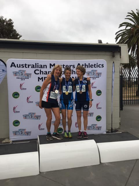 Helen Stanley on the podium for placing second in the Women's 60-64 5000m at the 2019 Australian Masters Athletics Championships