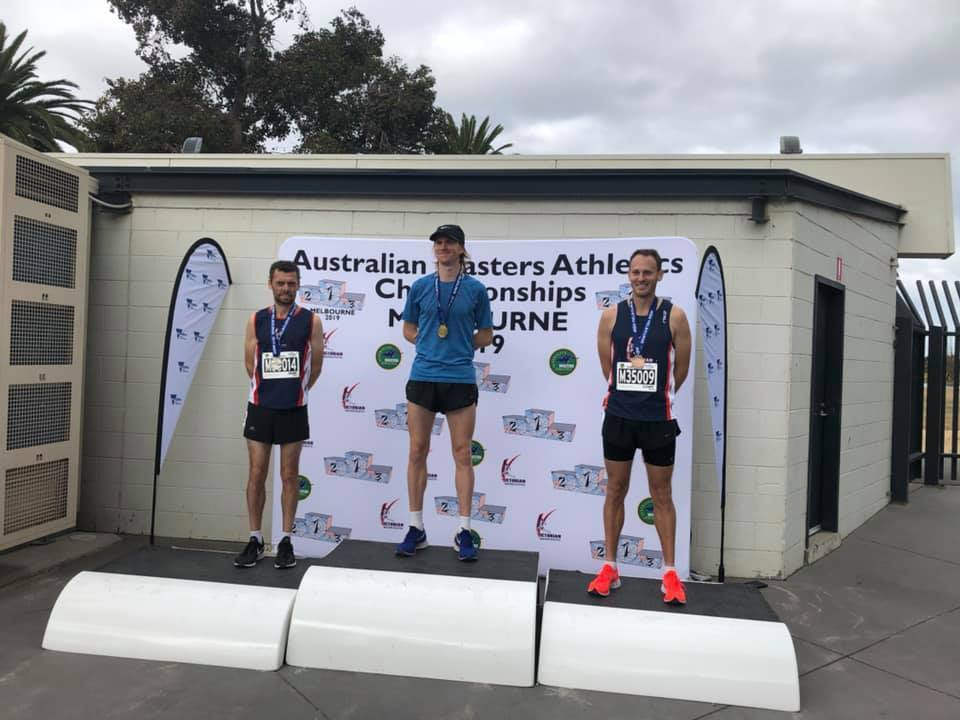 Shane Grund and Russell Clowes second and third in 2019 Australian Masters Athletics 5000m National Championships Men 35-39-podium
